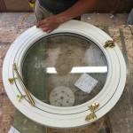 Opening Round hardwood window painted white wooden