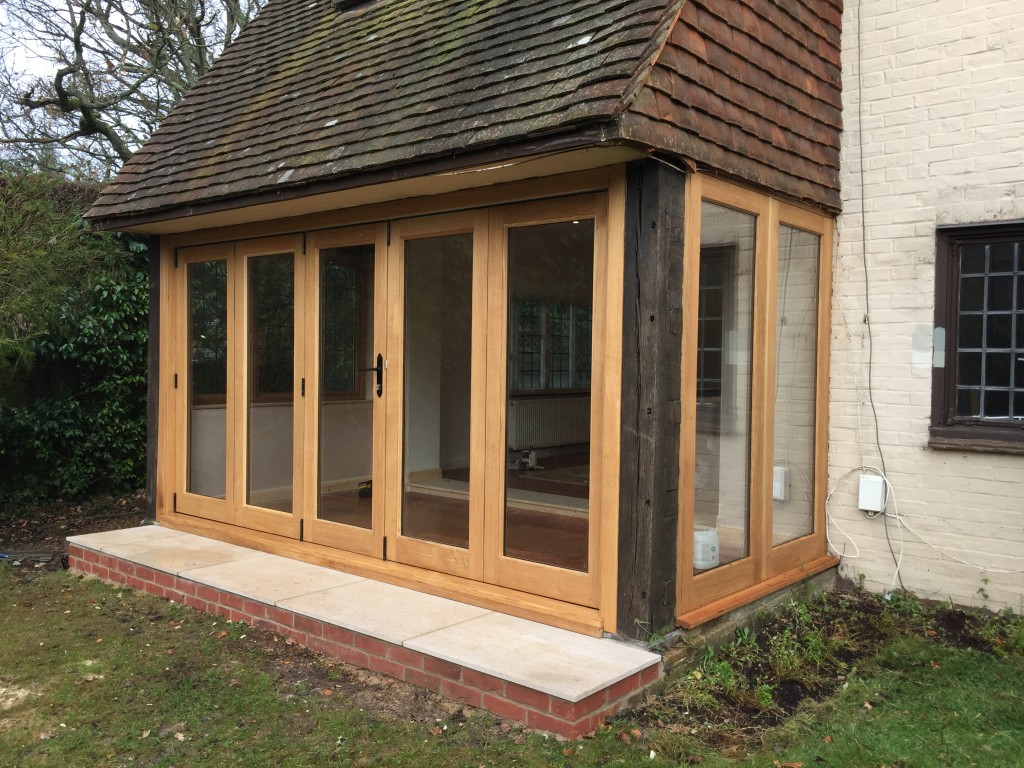 Oak Bifold sliding doors windows bi-fold