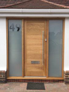 Oak door with glazed sidelights